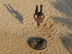 Mozambique, Maputo: Learning to fly (kool_skatkat) Tags: africa travel shadow man adam beach home topv111 jump sand topv333 topv222 uomo afrika mann blackman homem mies hombre mees tyre mozambique homme maputo burri pria mand travelphotography topf5 男人 человек muž koolskatkat 男 người גבר 남성 człowiek lalaki vyras رجل мъж ผู้ชาย férfi чоловік άντρασ raġel आदमी bărbat мушкарац moški muškarac vīrietis