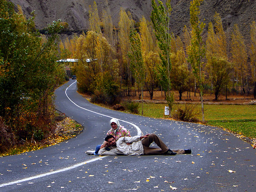 iranian man and woman on a country road in autumn