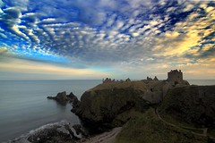 Dunnotar Castle Outake (bgladman) Tags: ocean uk travel sunset sea sky colour castle clouds spectacular landscape photography coast scotland photo nikon ruins d70 stock scenic dramatic escocia cliffs explore coastline colourful nikkor hdr highdynamicrange stonehaven schottland dunnotar scozia cosse tonemapped interestingness259 i500   bgladman  brendangladman