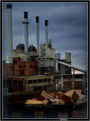 MG&E - Hyper real. (ABMann) Tags: dumpster landscape lomo lomography garbage nikon industrial d70 smoke debris nikond70s cardboard smokestacks electricity boxes nikkor stacks fauxmo hyperrealism detrus hyperrealiism nikkorlensnotacanoncameracanonusersareevil