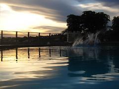 Everything calm until... (marlenells) Tags: blue sunset sky topf25 water freeassociation topc25 topv111 clouds reflections wonder interestingness topv555 topv333 topc50 swimmingpool 2550fav fv10 topv777 splash babel maringá instantfave abigfave