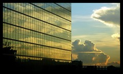 Waking up in Caracas (Xavier Donat) Tags: city building architecture clouds sunrise reflections venezuela caracas explore 213 explored granmelia 13112006