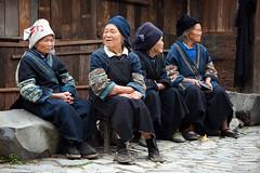 A village gathering (kevinlamphoto) Tags: china old travel ladies women asia sitting village chinese guizhou miao langde ethnic minority hmong minorities longde