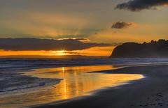Beach fire (borealnz) Tags: sunset sea newzealand cloud sunlight beach clouds reflections landscape evening seaside sand bravo surf quality nz otago dunedin rays tranquil stkilda magicdonkey greatsky otagonz outstandingshots specland artlibre magicdonkey25 eyeitup bppslideshow borealnz