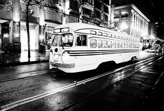 Night Train (Thomas Hawk) Tags: sanfrancisco california street city blackandwhite bw usa bus topf25 rain night train blackwhite unitedstates 10 trolley unitedstatesofamerica fav20 muni marketstreet streetcar fav30 ftrain fline marketst pcc fmarket fav10 fav25 fav40 superfave