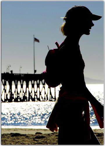 woman beach pier flag venturabeach silohuette
