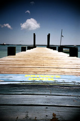 transpassing (szeing) Tags: travel film beach lomo lca lomography may 2006 bahamas harbourisland fujisuperia100 citywords privatedock wordofcaution