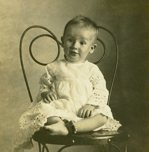 old photo of amused young child