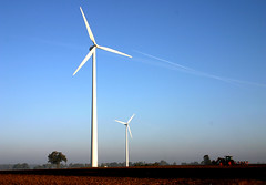 windpower 3 (Jasmic) Tags: morning blue two sky sun tractor slr windmill vertical digital canon germany landscape eos 300d contrail farm duo pair twin alternativeenergy explore farmer bergen turbine windpower