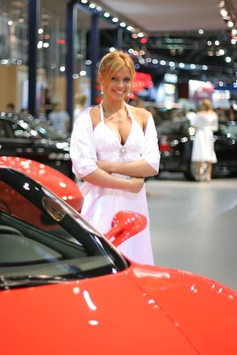 Smiling blond model and Ferrari F430