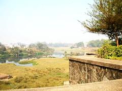 Mahavihara gardens and river beyond