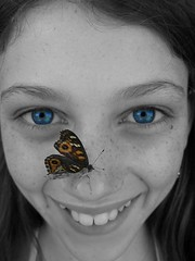 Blue eyed touchdown (Earlette) Tags: blue bw girl beautiful butterfly eyes daughter australian earlette weeklypatterns apcomp apcompnsw apcompnsw2006 apcompnsw2006november apcompnsw2006novemberb