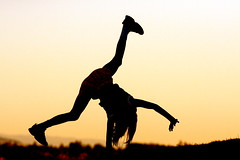 cartwheels at dusk (jodi_tripp) Tags: sunset tag3 taggedout concert bravo tag2 tag1 allie magic wsuv cartwheel allrightsreserved magicdonkey joditripp cy2 challengeyouwinner 3wayicon 3waychallengewinner artlibre 3waychallengeiconwinnersept25 wstpic07 wwwjoditrippcom photographybyjodtripp joditrippcom