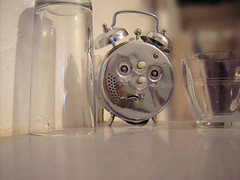miserable-clock (mohawk) Tags: copyright reflection cute alarm clock feet water glass face metal bells liverpool silver lost photography missing key alone photographer shine sad emotion bell d object poor dial inanimate twist surface sean hidden reflect chrome angry mohawk mean alive feeling emotional without 2009 squiggle empathy pyrex upset zinc wirral animate clanger objective plated limbert melamine