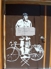 cryptic comment(ary) (trepelu) Tags: brown bike bicycle southdakota alley grafitti stencilart metaldoor cardboardsign rapidcitysd