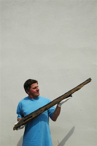 Team member with the remains of a musket
