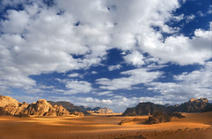 Wadi Rum II (zerega) Tags: travel shadow sky cloud mountain color colour rock clouds analog landscape geotagged sand scenery asia mood dune wadirum scenic middleeast dramatic peak slide lookout jordan arab journey valley arabia nomad majestic lawrenceofarabia highlight jordanien overview bedouin allure jordania jebel bedu mediooriente nabataean telawrence nationalreserve jordani kingdomofjordan desertpatrolcorps huweitat aramaua lpdry