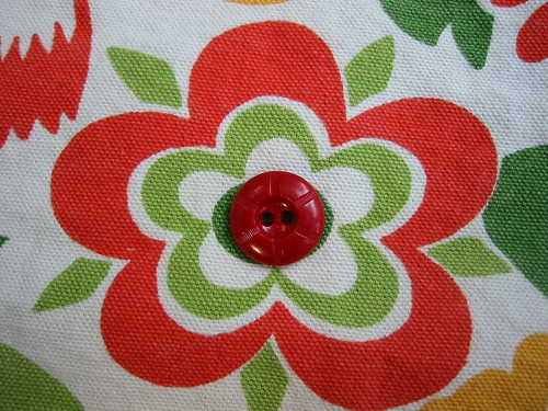 Buttons on the center of each flower