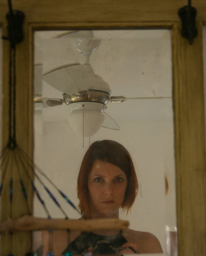 dirty mirror, ceiling fan, driftwood glass wind chime, and me.