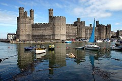 Caernarfon Castle - Caernarfon - Wales ({ Planet Adventure }) Tags: uk favorite 20d wales canon wonderful landscape eos cool hit holidays flickr good canon20d perspective creative ab lindo backpacking 100views winner stunning excellent pro iwasthere 200views geology bliss incredible tagging canoneos allrightsreserved astar nicecolors high5 beautifulscenery havingfun onflickr visittheworld ilovethisplace fantastica caernarfoncastle thewest travelphotos 4aces facinating verycool greatcolors 5favs placesilove traveltheworld beautifulplace 5faves travelphotographs canonphotography beautifulshot beautifulcomposition alwaysbecapturing worldtraveller planetadventure 5favorites lovephotography easter2006 123faves greatcomposition beautyissimple 20060415 greatplace theworlthroughmyeyes tedesafio flickrpoker challengeyouwinner peopleseemtolike supperb flickriscool loveyourphotos theworldthroughmylenses greatcaptures shotingtheworld by{planetadventure} byalessandrobehling icanon icancanon canonrocks selftaughtphotographer phographyisart travellingisfun cameracraze xploremypix laterallycool awesomelandscape beautyfullandscape ratedpro copyright20002006alessandroabehling 10to1 perfectpic exploremypix interestingplace visitthisplace athumbsup flickrsmille allinteresting allwales justwales greatwales visitwales