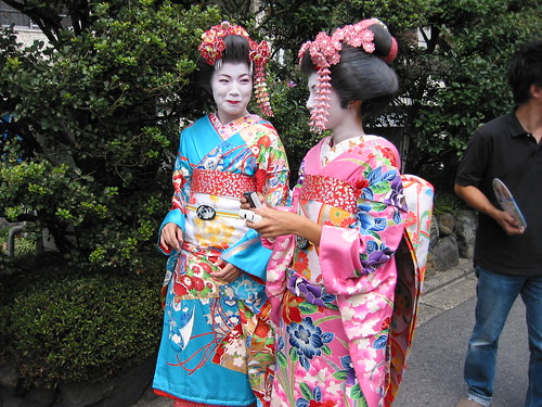 A geisha and a maiko share a joke, Kyoto, Japan