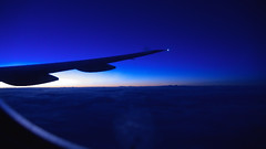 At the break of dawn (smine) Tags: blue orange sun yellow clouds airplane dawn flight transition  asist2006 pdpnw