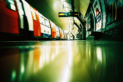 London Underground (edscoble) Tags: china camera london film station train 35mm underground landscape lomo lca xpro lomography xprocess crossprocess tube ct railway slide soviet plus agfa russian automat morden northernline londonist c41 precisa kompakt southwimbledon deeplevels flickrplatinum