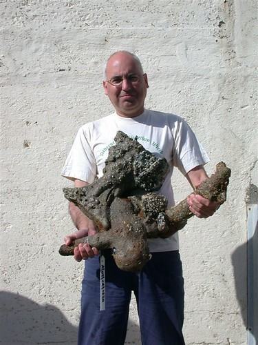 Team member Robin King with a concretion from the wreck.  The curved sides of a powder flask can be seen on the left.