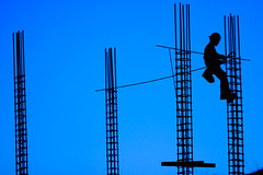 work (♫ marc_l'esperance) Tags: blue light sky man silhouette canon eos site construction bc dusk © working 2006 victoria climbing condo 10d cropped minimalism development minimalist rebar condominium allrightsreserved cml songhees crd canonef70200mmf28lusm canon70200f28l