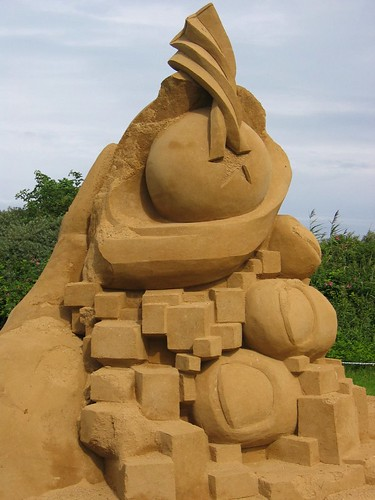 sand sculptures, images of beauty and perfection, pretense