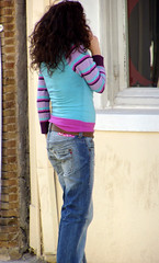 Girl in Jeans with Cellphone