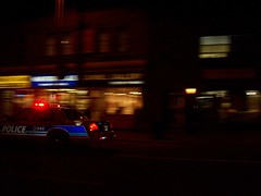 A City of Ottawa Ford Crown Victoria police car in hot pursuit of someone on Bank Street. (Steve Brandon) Tags: auto city light ontario canada car night geotagged lights evening automobile downtown ottawa trails fast voiture motionblur policecar chase streams streaks soir nuit siren ville pursuit centreville bankstreet crownvictoria bankst  policecruiser crownvic lightbar fordcrownvictoria  policiers policeinterceptor voituredepolice ottawaphotography ruebank ottawapolice ottawapoliceservice    ottawaphotographer