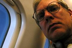 le 29 novembre (O Caritas) Tags: selfportrait me self plane inflight ocaritas nikoncoolpix8800 daily50 dscn1157jpg