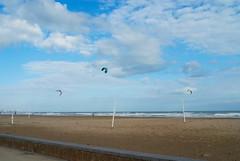 Kites (Riccardo Mori) Tags: cloud sky sea beach valencia people kite nikon d200 building