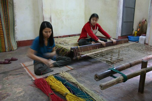 Traditional handwork. Hoi An silk shop.