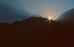 sunrise on les Drus (Ron Layters) Tags: france mountains alps nature sunrise geotagged slide transparency kodachrome chamonix rescanned kodachrome64 hautesavoie geo:lat=45934199 geo:lon=6949196 flickrfly lesdrus ronlayters slidefilmthenscanned massifdumontblanc flammesdespierres