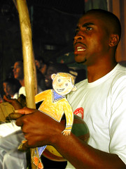 Flat Stanley plays the Berimbau (carf) Tags: girls friends brazil music playing art sports boys brasil kids children fun drums hope dance kid community capoeira child play hummingbird esperana social games berimbau capoeirabeijaflor caleb beijaflor flatstanley hapakorean ecbf