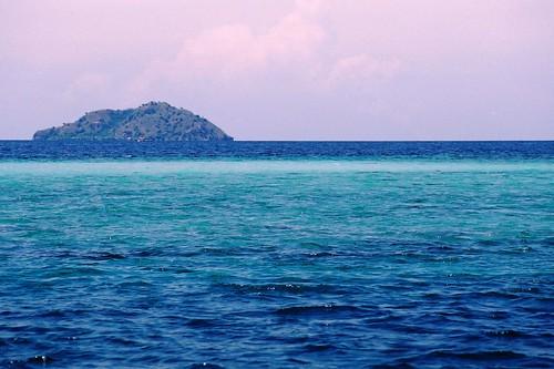 Small island and turquoise sea