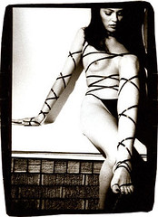 wrap (* Sontheimer Pictures *) Tags: bw woman sexy film topf25 girl lady contrast darkroom 35mm canon foot interestingness interesting shoes toe kodak feminine femme trix sensual wig ribbon manual brunette mantle naughtypants sjs2 jls11 jrs7