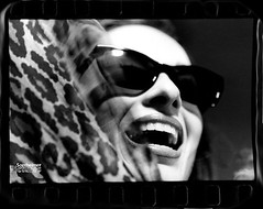 Sunglasses (* Sontheimer Pictures *) Tags: blackandwhite woman film smile sunglasses darkroom canon women kodak teeth trix convertible manual sjs2 jls11 jrs7