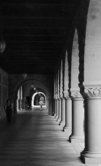 The Halls of Stanford (Akash k) Tags: california light blackandwhite bw white black architecture vanishingpoint university perspective arches stanford cannon pillars sadows 123bw