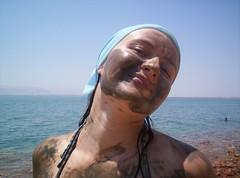 Dirty Girl (Little Lushie) Tags: blue sea summer portrait sun beach scarf fun mask mud bright resort jordan grin deadsea movenpick