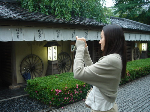 Mizuka taking pictures for her blog