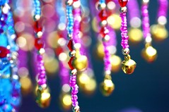 A Colorful Saga (!efatima) Tags: topf25 bells catchycolors beads topv333 dof dress bokeh topc50 efatima jewelryornaments fatimahadi mirrorreflection oranments