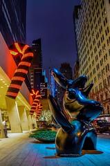 Manhattan Festive mood.Solow, 9th West 57th st. NYC (mitzgami) Tags: nightphotography decoration 9west57thstreet moonbird joanmiro sculpture longexposure d7000 nikonphotography candycane christmas inexplore flickr newyorkcity manhattan solowbuilding
