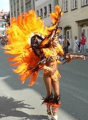 Street Parade at the Samba Festival in Coburg - P1050174 (Andreas Helke) Tags: 2005 street orange woman color topv111 festival germany deutschland dance topv333 samba coburg europa europe 5 gutentag topv1111 performance parade tanz fav frau popular umzug 1205 fav5 sr141 candreashelke v2000 2005121430 2005121734 2005121838 2006010256g worldsfavorite 200604091031 200606052482 200606183542 haslargesize donothide 200702199083 200702249204 20070305955 oldstileoriginalsecret 2007061210834 fav5andmore fav2andmore popularold