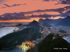 the marvellous city - rio de janeiro (chillntravel) Tags: ocean city travel sunset brazil urban southamerica brasil riodejaneiro wow interestingness interesting published 500v20f cidademaravilhosa topv1111 topf300 cristoredentor christtheredeemer corcovado copacabana apex 50100fav stunning blogged nightscene sugarloaf topf150 topv3333 topv4444 topf100 topf200 ipanema arpoador beautifulscenery paodeacucar topf500 1000places topf600 frhwofavs great123 cristredeemer