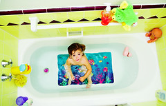 taking off again (sesame ellis) Tags: girl toddler colorful bright mykid fromabove bathtub year2 tc63above monitorrgb yesthetilesarethatcolor itwasworsewhenthewallswerepeach