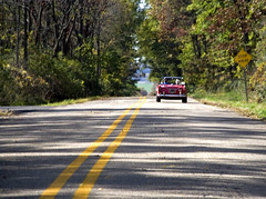 'let's take a drive' , she offered. (McBeth) Tags: autumn wisconsin roadsign doubleyellow stopahead leadingline redsportscar