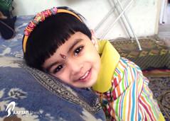 Adorable (Aaftab Sheikh) Tags: pakistan baby color girl smile yellow k750i islamabad bindiya aaftab hiarband urbaaaftab urbaaftab